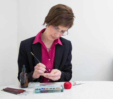 Image of Bev painting an artificial eye